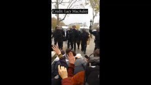 Paris police use batons on climate protesters caught on camera